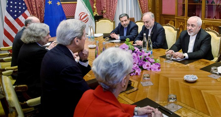 (From left) Robert Malley, of the US National Security Council, US Secretary of Energy Ernest Moniz, US Secretary of State John Kerry, US Under Secretary for Political Affairs Wendy Sherman, Iranian Deputy Foreign Minister Abbas Araghchi, Head of Iranian Atomic Energy Organisation Ali Akbar Salehi and Iranian Foreign Minister Javad Zarif wait for a meeting at the Beau Rivage Palace Hotel March 27, 2015 in Lausanne, Switzerland