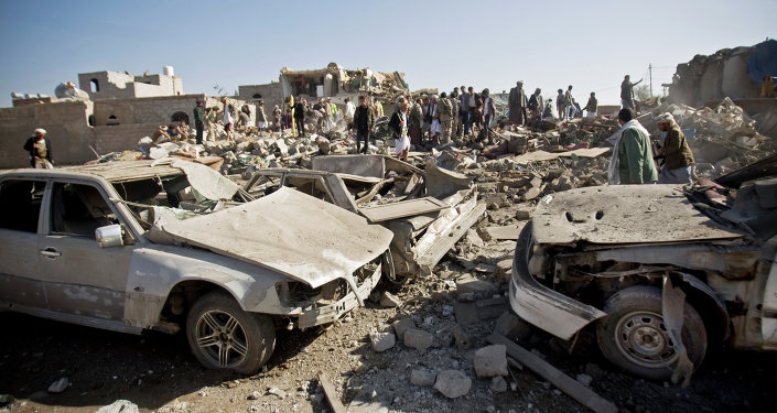 People search for survivors under the rubble of houses destroyed by Saudi airstrikes near Sanaa Airport, Yemen, Thursday, March 26, 2015