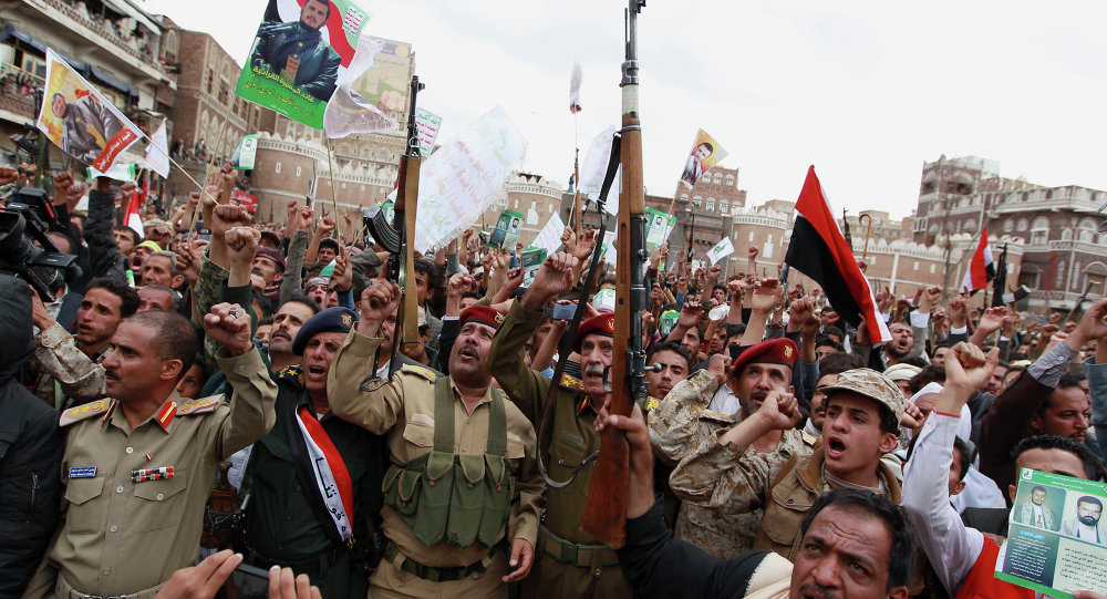 Shiite rebels, known as Houthis, gather to protest against Saudi-led airstrikes, during a rally in Sanaa, Yemen