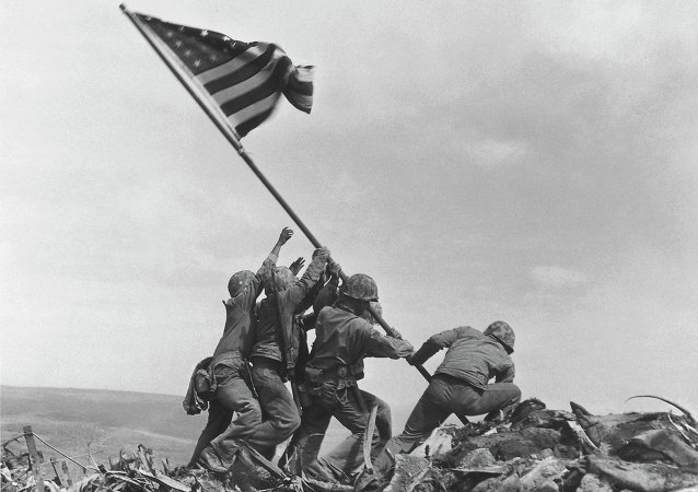 US Marines of the 28th Regiment, 5th Division, raise the American flag atop Mt. Suribachi, Iwo Jima