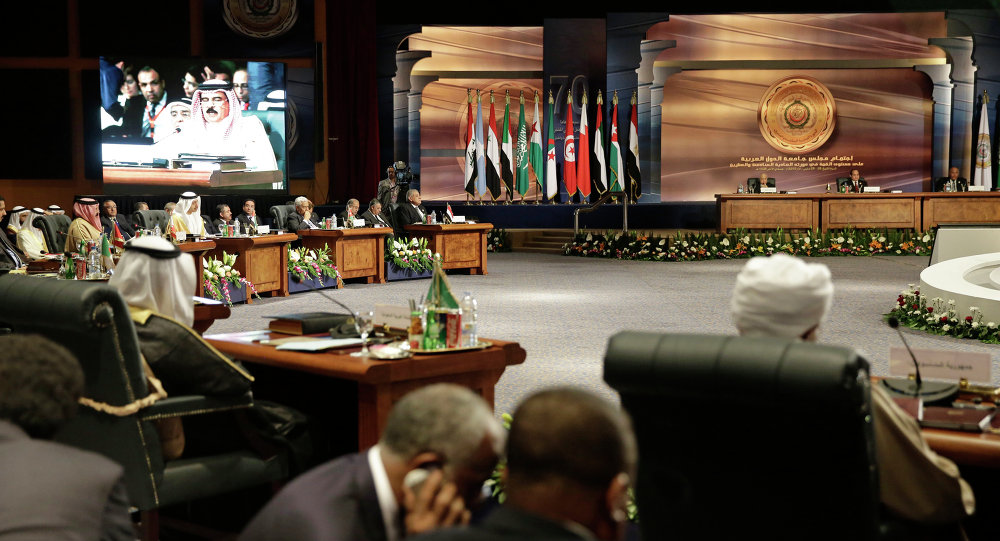Arab heads of state meet as King Hamad bin Isa Al Khalifa of Bahrain, seen on screen, speaks, in Sharm el Sheik, South Sinai, Egypt, Saturday, March 28, 2015