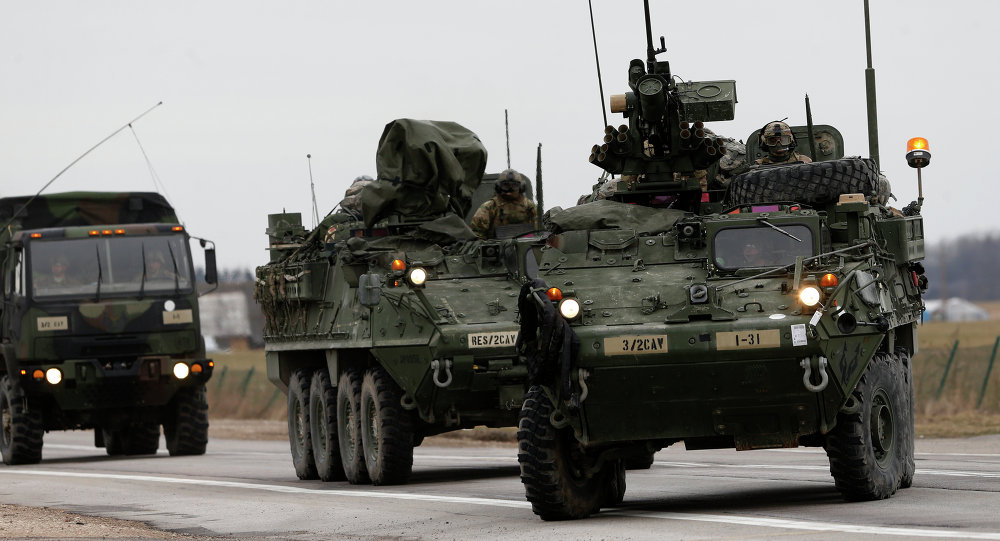 Stryker vehicles of the US Army's 2nd Cavalry Regiment roll down the way during the ''Dragoon Ride'' military exercise in Salociai some 178 kms (110 miles) north of the capital Vilnius, Lithuania, Monday, March 23, 2015