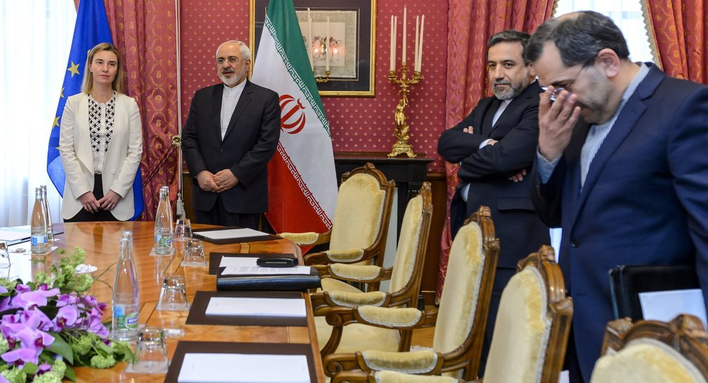 EU foreign policy chief Federica Mogherini (L) meets Iranian Foreign Minister Mohammad Javad Zarif (2nd-L) and Iranian Deputy Foreign Minister Abbas Araghchi (2nd-R) during Iranian nuclear talks in Lausanne on March 29, 2015