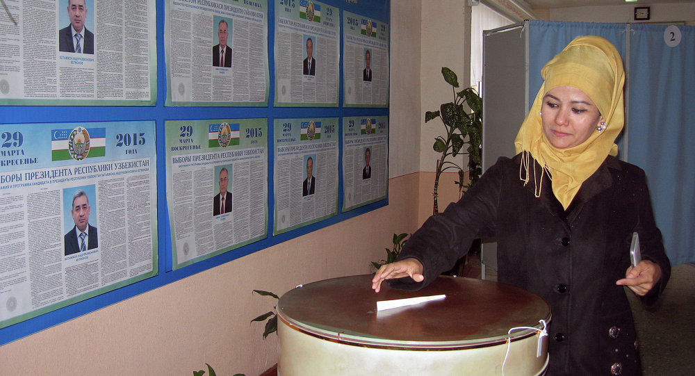 A woman casts her ballot at a polling station in Tashkent on March 29, 2015