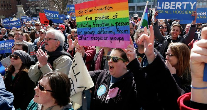 Demonstrators gather at Monument Circle to protest a controversial religious freedom bill recently signed by Governor Mike Pence during a rally in Indianapolis March 28, 2015