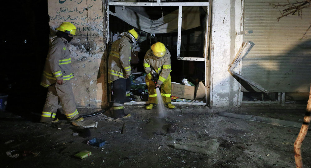 Afghan firefighters spray water at the site of a suicide attack targeting parliamentarian Gul Pacha Mujedi in Kabul, Afghanistan, Sunday, March 29, 2015