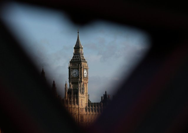 The Houses of Parliament are seen during sunrise in London March 30, 2015