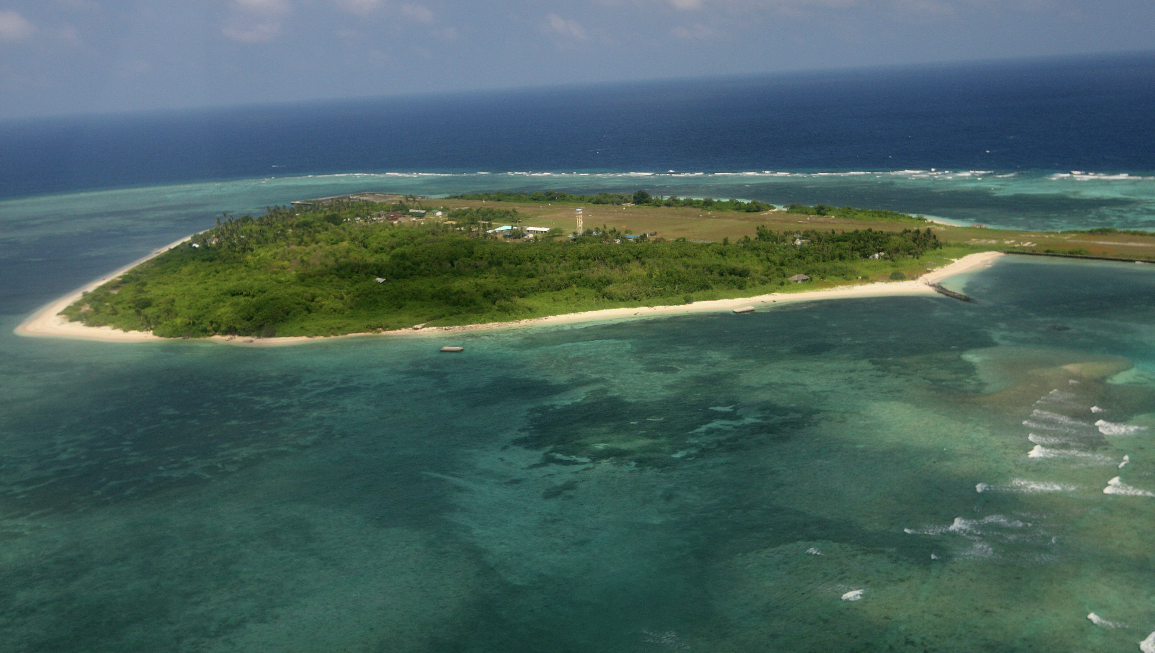 An aerial photo shows Thitu Island, part of the disputed Spratly group of islands, in the South China Sea located off the coast of western Philippines.