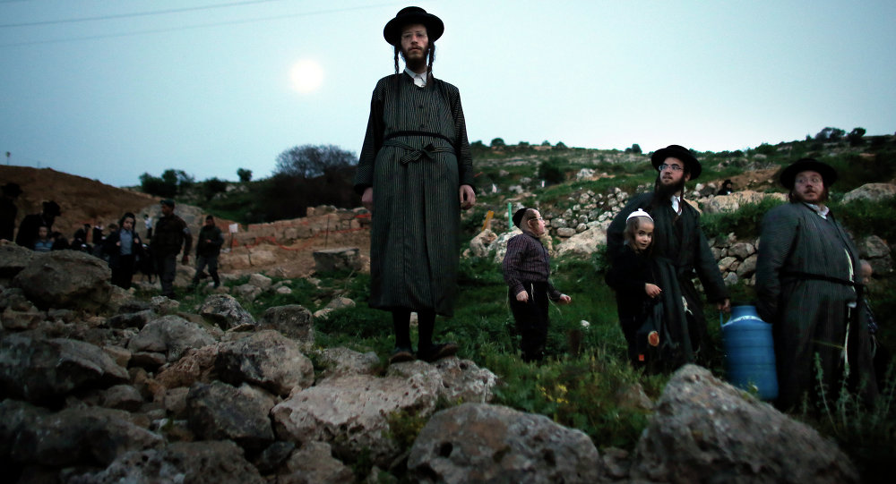 Ultra-Orthodox Jews leave the site after collecting water from a mountain spring near Jerusalem to be used in baking unleavened bread, known as Matzoth, during the Maim Shelanu (Rested Water) ceremony on April 2, 2015.