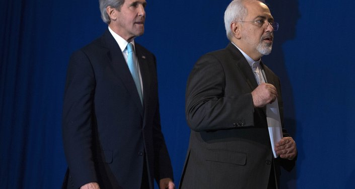 US Secretary of State John Kerry, left, and Iranian Foreign Minister Javad Zarif arrive to deliver a statement, at the Swiss Federal Institute of Technology, or Ecole Polytechnique Federale De Lausanne, in Lausanne, Switzerland, Thursday, April 2, 2015