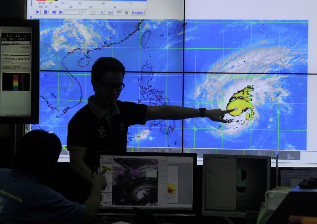 Meteorologists from the Philippine Atmospheric, Geophysical and Astronomical Services Administration (PAGASA) monitor and plot the direction of super typhoon Maysak at PAGASA headquarters in suburban Manila on April 1, 2015