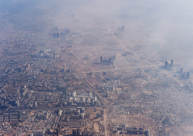 Smog envelops buildings on the outskirts of the Indian capital New Delhi