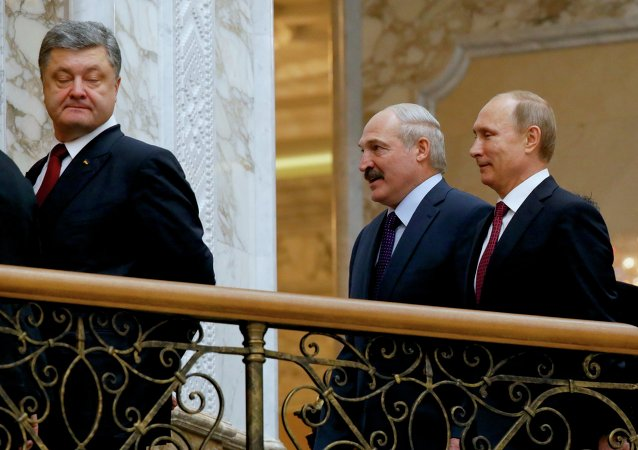 Ukrainian President Petro Poroshenko, left, is followed by Russian President Vladimir Putin, right, and Belarusian President Alexander Lukashenko, heading for a broader meeting involving senior officials in Minsk, Belarus, Wednesday, Feb. 11, 2015