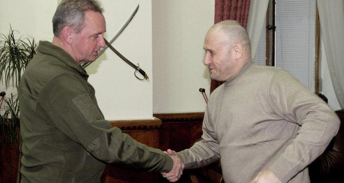 Ukrainian Chief of General Staff Viktor Muzhenko (left) meeting with Right Sector leader Dmytro Yarosh (right)
