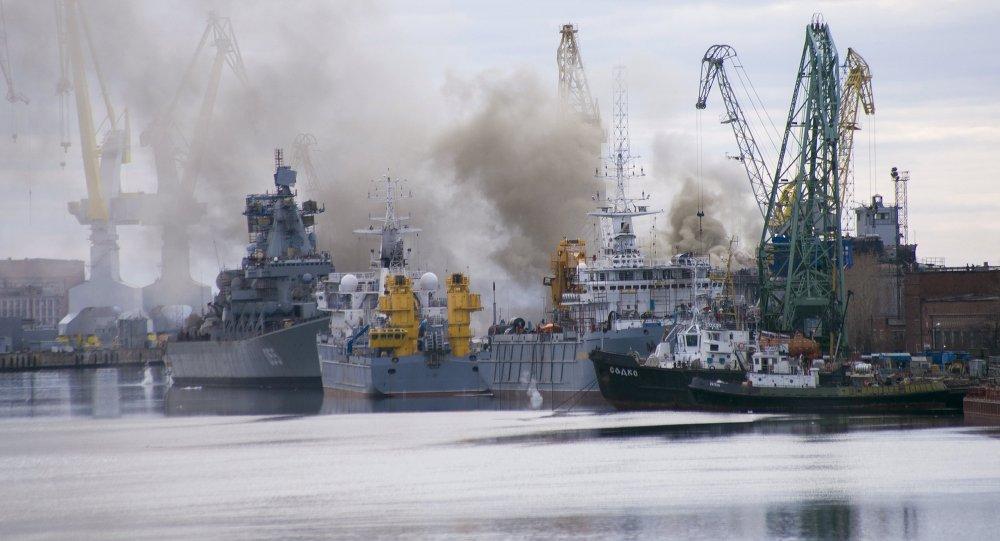 A general view shows smoke rising above a dock at the Zvyozdochka shipyard in the north Russian city of Severodvinsk April 7, 2015