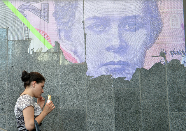 A woman eats ice-cream next to a torned poster depicting Ukrainian 200-hrivnya banknote at the metro entrance in Kiev