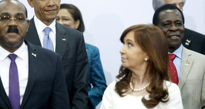 U.S. President Barack Obama (2nd L) shares a look with Argentina's President Cristina Fernandez de Kirchner (front R) during a group photo at the first plenary session of the Summit of the Americas in Panama City, Panama