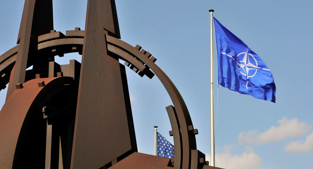 A picture taken on March 2, 2014 shows the NATO flag in the wind at the NATO headquarters in Brussels.