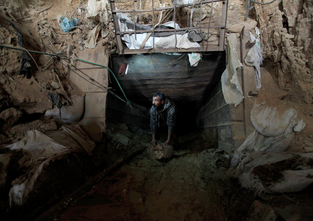 A Palestinian cleans a tunnel in Rafah, on the border between Egypt and the southern Gaza Strip