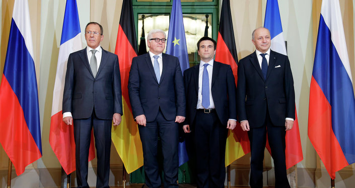 German Foreign Minister Frank-Walter Steinmeier, second left, welcomes his counterparts from France, Laurent Fabius, right, Russia, Sergey Lavrov, left, and Ukraine, Pavlo Klimkin, second right, for a meeting on the situation in Ukraine in Berlin, Germany, Monday, Jan. 12, 2015.
