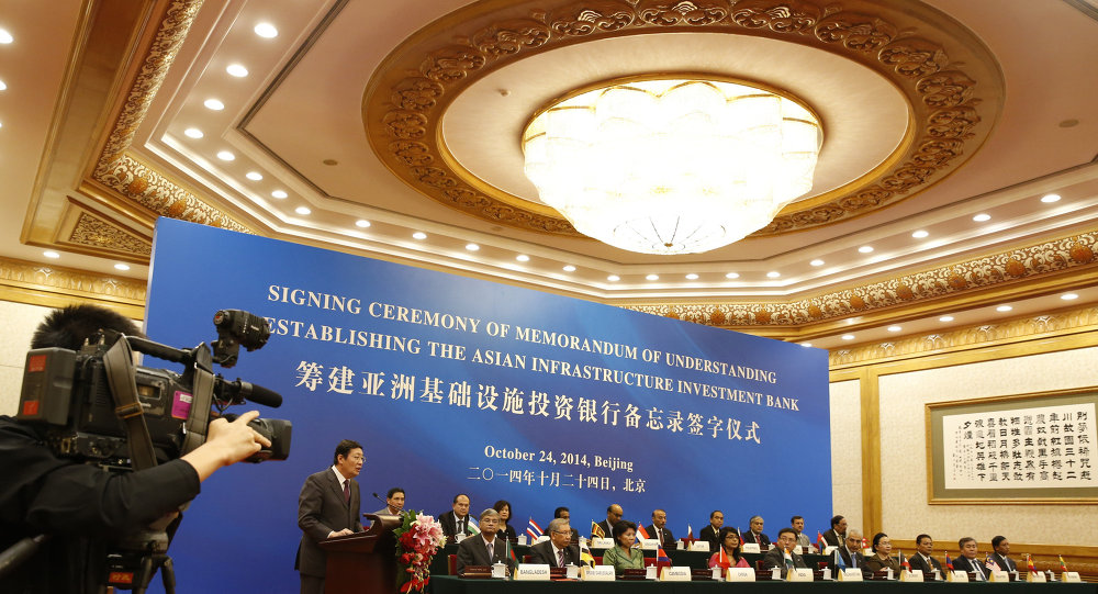 Chinese Finance Minister Lou Jiwei (2nd L) gives a speech for guests at the signing ceremony of the Asian Infrastructure Investment Bank at the Great Hall of the People in Beijing