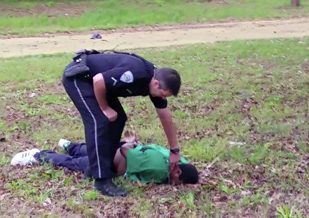 Michael Thomas Slager checks Scott's pulse in North Charleston, S.C. Slager was charged with murder on Tuesday, April 7, hours after law enforcement officials viewed the dramatic video that appears to show him shooting a fleeing Scott several times in the back
