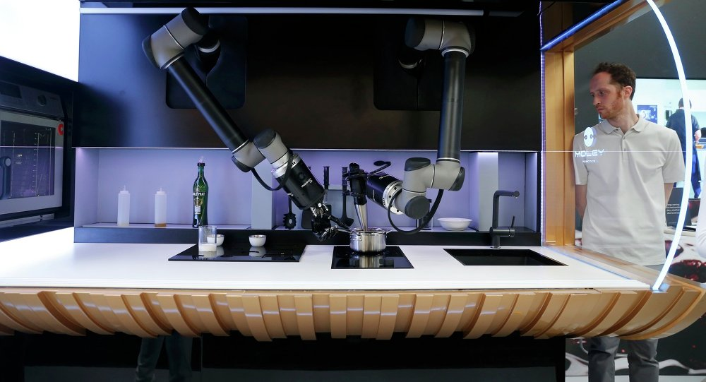 A robot in the Robotic Kitchen prototype created by Moley Robotics cooks a crab soup at the company's booth at the world's largest industrial technology fair, the Hannover Messe, in Hanover April 13, 2015