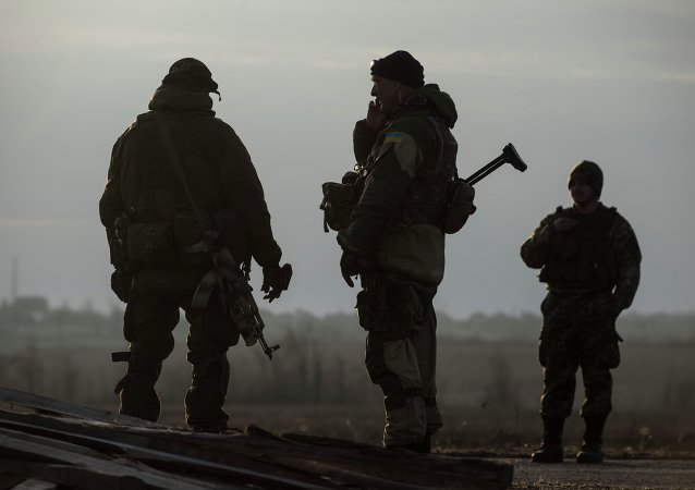 Ukrainian servicemen guard their position in the village of Shirokino near Mariupol, eastern Ukraine, Wednesday, February 25, 2015.