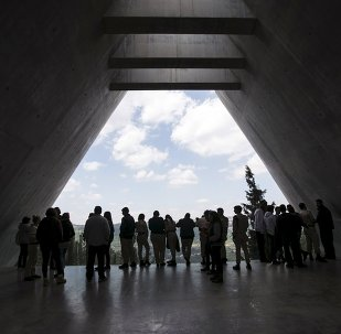 Visitors stand in Yad Vashem's Holocaust History Museum in Jerusalem