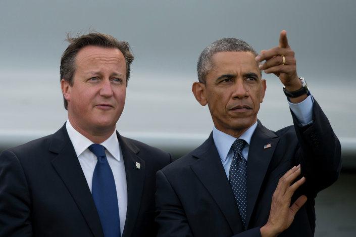 US President Barack Obama, right, stands alongside British Prime Minister David Cameron