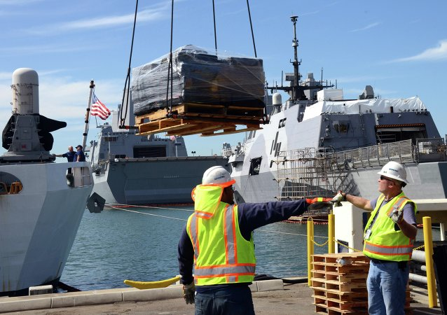 Crewmembers of U.S. Coast Guard Cutter Boutwell and civilian crane operators offload 28,000 pounds of cocaine at Naval Base San Diego Thursday, April 16, 2015. The vessel arrived with more than 14 tons of cocaine, part of what authorities described as a surge of seizures near Central and South America.