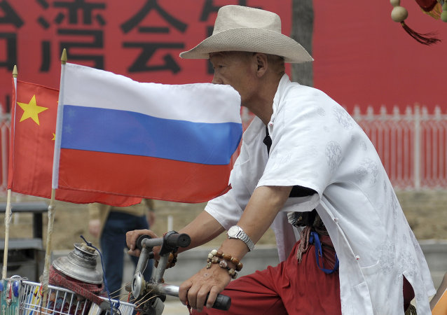 A man rides with a Russian flag displayed on his pedicab in Beijing's Russian trade district of Yabaolu. (File)