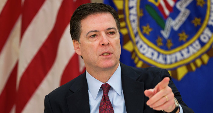 FBI director James Comey gestures during a news conference at FBI headquarters in Washington, Wednesday, March 25, 2015