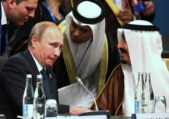 President of Russia Vladimir Putin and Crown Prince Salman bin Albdulaziz Al Saud talk through their interpreters during a plenary session at the G-20 summit in Brisbane, Australia, Saturday, Nov. 15, 2014
