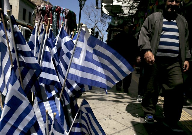 Greek national flags are on display at a shop in central Athens April 17, 2015