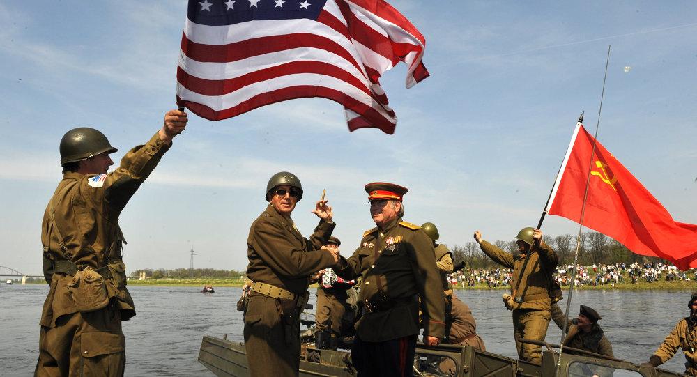Amateur actors re-enact the linkup of Soviet and American troops 65 years ago, in Torgau, eastern Germany, on Saturday, April 24, 2010