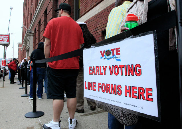 File photo, voters stand in line outside the Hamilton County Board of Elections just before it opened for early voting, in Cincinnati