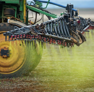 Herbicide is sprayed on a soybean field