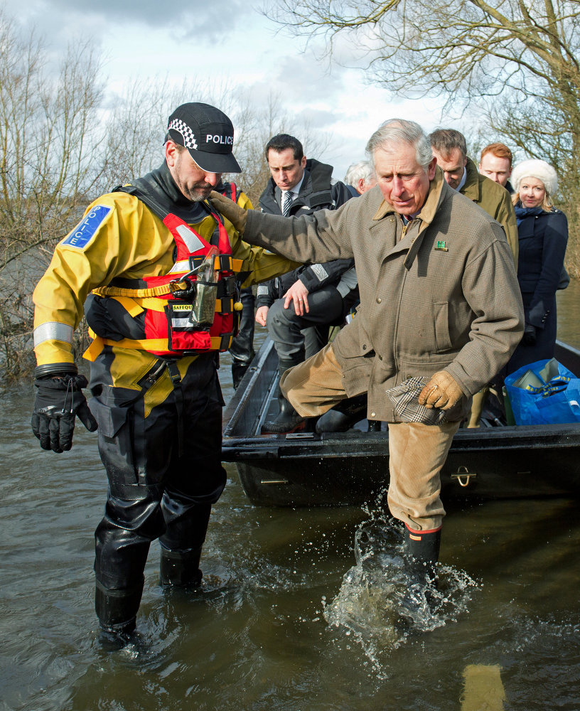 Britain's Prince Charles, right, disembarks from his transport during the tour to visit the flood hit area in southwest England in 2014.
