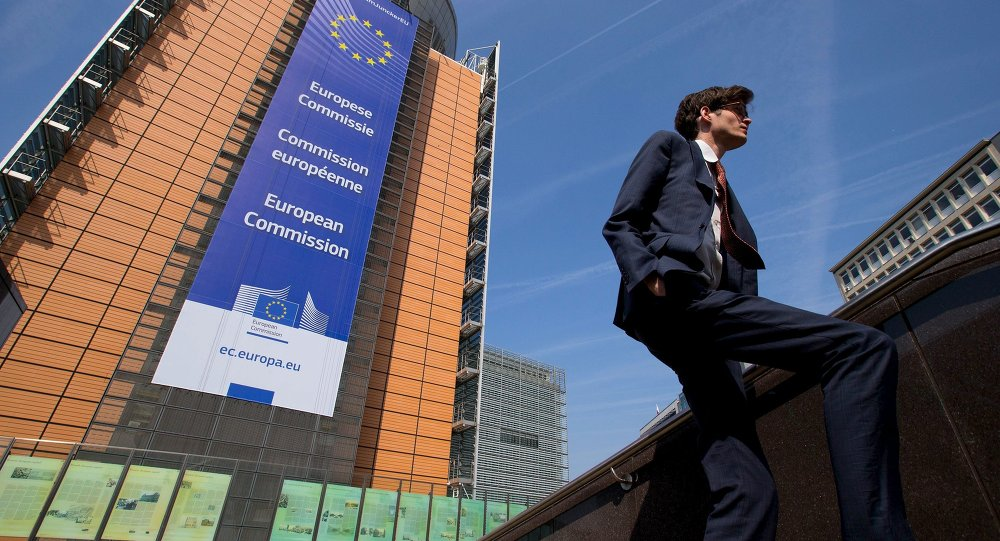 A man walks past the European Commission headquarters in Brussels April 9, 2015