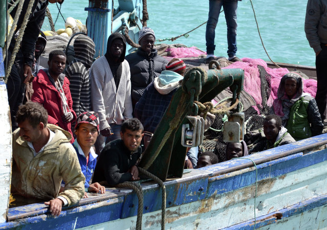 Migrants arrive at the port in the Tunisian town of Zarzis, some 50 kilometres west of the Libyan border, following their rescue by Tunisia's coastguard and navy after their vessel overturned off Libya, on April 13, 2015