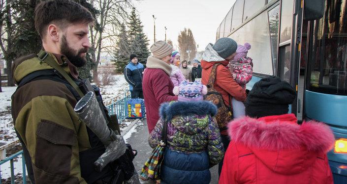 Militia of the Angel volunteer peacekeeping unit evacuate Donbas refugees