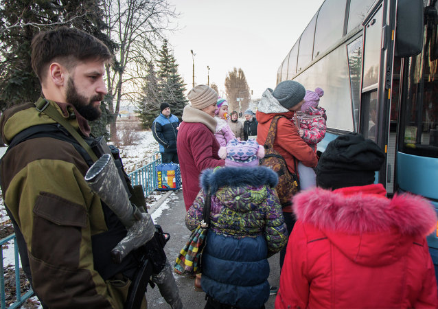 Militia of the Angel volunteer peacekeeping unit evacuate Donbas refugees