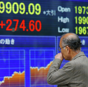 A man looks at an electronic stock indicator of a securities firm in Tokyo