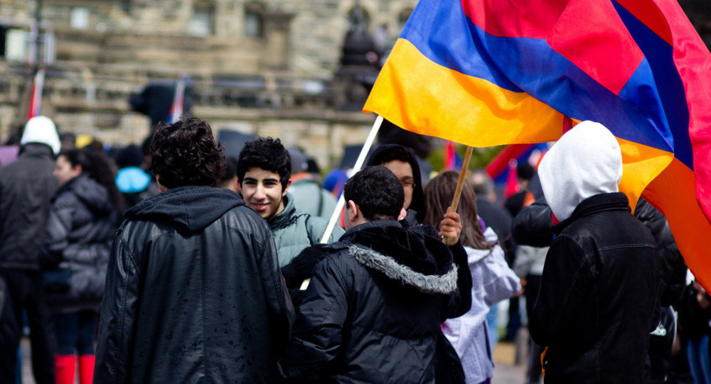 Young people holding the Armenian flag