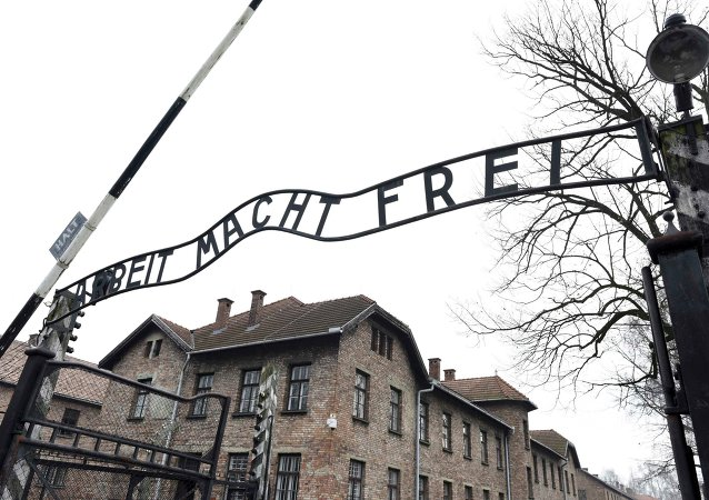 File photo of the sign Arbeit macht frei (Work Makes You Free) at the main gate of the former German Nazi concentration and extermination camp Auschwitz in Oswiecim January 19, 2015.