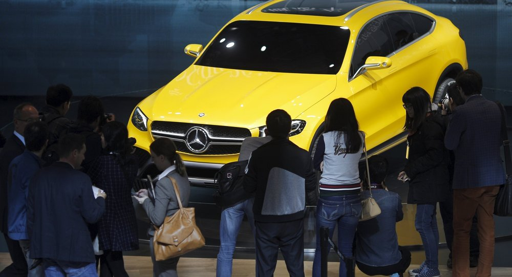 Visitors walk around a Mercedes Benz concept GLC Coupe car during the 16th Shanghai International Automobile Industry Exhibition in Shanghai