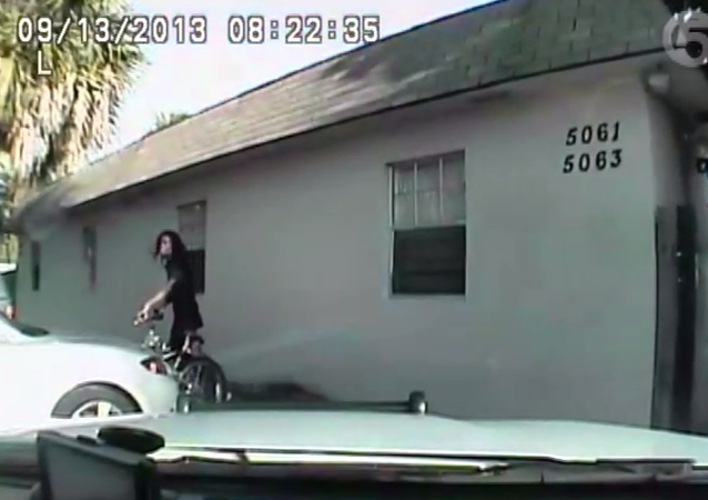 Newly released footage of a 2013 incident shows a Palm Beach, Fla. sheriff's deputy shooting an unarmed man holding a cell phone within seconds of stopping him.