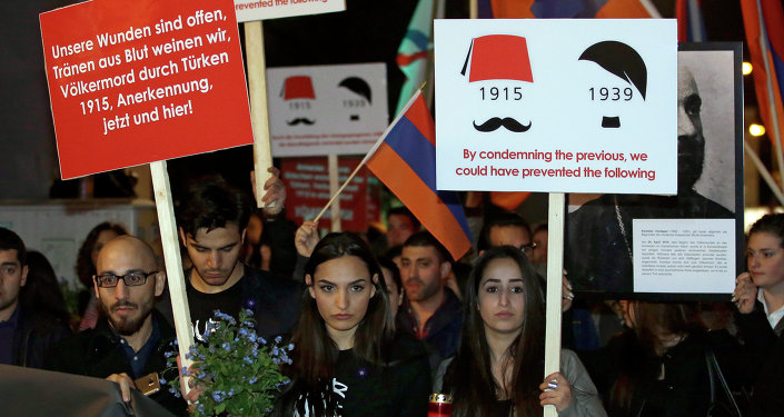People take part in a demonstration after an ecumenical service remembering the Armenian 'slaughter' at the Berlin Cathedral Church in Berlin, Germany, Thursday, April 23, 2015