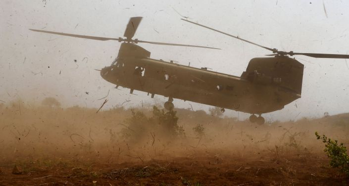 A U.S. military helicopter CH-47 lands during the annual Balikatan (shoulder-to-shoulder) war games with Filipino soldiers at a military camp, Fort Magsaysay, Nueva Ecija in northern Philippines April 20, 2015.